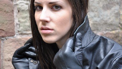 girlinleatherpantsandleatherbootswithjacketgloves