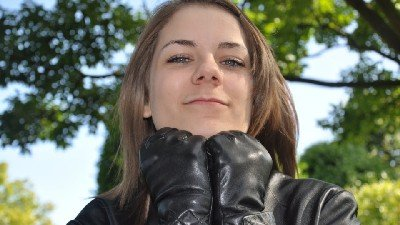 girlinleatherglovesandjacket
