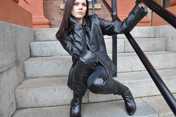 girl-in-leather-boots-and-leather-jacket-with-leather-gloves